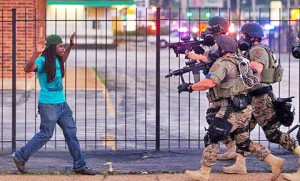 Militarized Police in Ferguson, MO confront an unarmed citizen