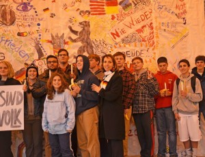 "Woodgrove German teacher, Effie Hall (center), with students ""protesting"" the Berlin Wall"