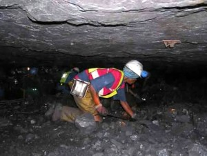 Coal miners crawl in mines no taller than a table top