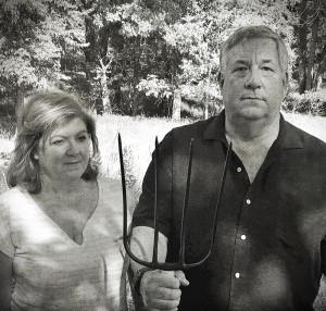 Mike and Sian Pugh in the Meadow he's defending – an echo of American Gothic?
