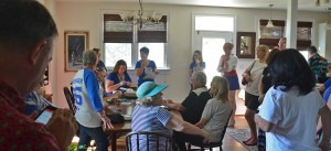 Kristen K. Swanson (left of center) convenes her Saturday organizing meeting